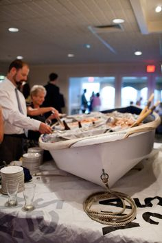 Love the use of sails as table clothes for oyster bar....Love the whole idea of this especially around a pool!