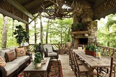 the rustic cabin by emily powell | laid back and luxurious cabin porch proof that you can mash up rustic ...
