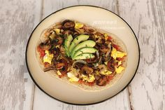 Breakfast Pizza! 1 Flatout Optional toppings 2 t salsa 1 green container of mushrooms and onions 2 eggs 1/4 sliced avocado Extra virgin olive oil ...
