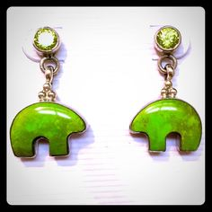 """Native American Turquoise Peridot Bear Earrings Gorgeous Native American sterling silver & green peridot post earrings with friction backs that feature dangling green turquoise bears. Each earring is stamped """"Sterling"""" on the back. Perfect condition and charmingly enchanting to behold. The Bear symbolizes the most powerful animal who is a Guardian of the Earth.  Most prevalently, the symbol of the bear is a sign of spiritual and physical power and courage. The bear symbolizes physical…"""