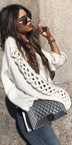 white loose sweater grey jeans silver bag