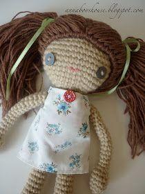 free crochet amigurumi doll pattern I like the little fabric dress on this one...