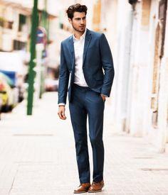 Blue suit, brown shoes.
