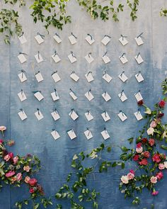 A Gem-Toned Texas Wedding with French Touches | Martha Stewart Weddings - The couple's love of art was honored with a three-panel wooden escort card display using ombré painted tapestries by Kayla Barker draped with fresh flowers. The seating assignments themselves were grey cards featuring plum calligraphy by The Left Handed Calligrapher, hanging with navy ribbon.