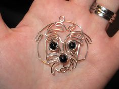 This pendant is for anyone who loves dogs! SELECT YOUR COLOR WIRE AT CHECKOUT Its handmade and wire wrapped with your choice color wire into this adorable little dog head! its wrapped up with a cute little black nose and two little black color eyes. The nose and eyes are made with