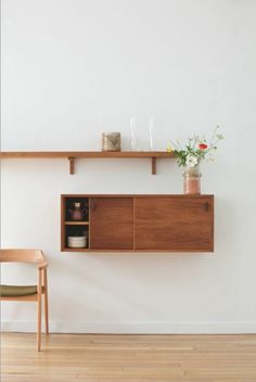 mounted sideboard with sliding wood on the wall