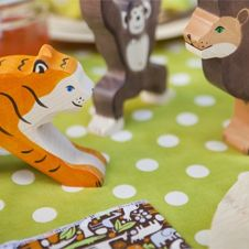 Favor idea: Wooden animals in animal-print fabric bags - National Zoo theme from ACME Party Box Company