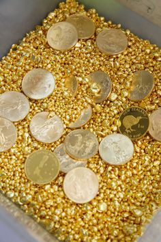99.99% pure Fine Gold granules with 99.99% pure gold minted coins. To veiw more of avalible bullion products see here - http://morrisandwatson.com/bullion