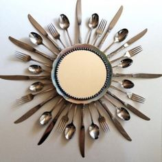 decorate a mirror with old silver cutlery