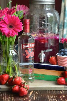 Add a little punch to your Memorial Day party with this quick and easy Mixed Berry Vodka Punch recipe made with frozen berries, fresh lemons, and Smirnoff Raspberry. Seriously THE best way to serve summer cocktails for a crowd. #AD #Punch4Everybody @smirnoffus  | Always Order Dessert