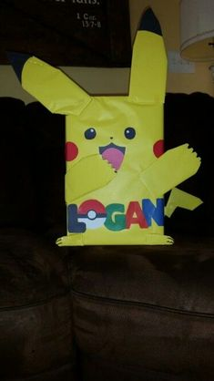 Used a saved shoe box and some wrapping paper from Dollar Tree. After school Valentine's party, he can put it in his room! This craft idea would be great for a birthday party too. Could make Spongebob, a minion, etc. Pokemon Valentines Box, Valentine Day Boxes, Pokemon Birthday, Valentines Day Treats, Valentines For Boys, Valentines Day Decorations, Valentine Day Crafts, Valentine Ideas, Johnny Valentine