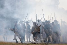 American troops charge through the smoke in the Battle of Yorktown.