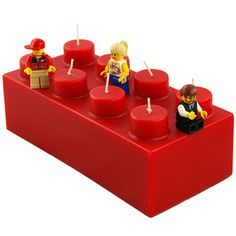 Bake a rectangle cake and use votive candles as the Lego circles and birthday candles!!