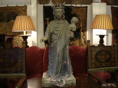 Large simulated stone carving of the Madonna arms outstretched, displayed in the Farley showroom. **All items available to hire** www.farley.co.uk