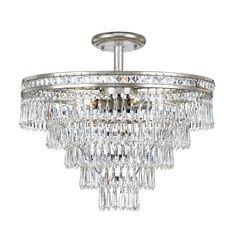 "TOTAL NUMBER LIGHTS: 7 EXTERNAL LIGHTS: 6 INTERNAL LIGHTS: 1 TOTAL WATTAGE: 420 BULB TYPE: Candelabra MATERIAL: Steel + Crystal FINISH: Olde Silver CHAIN LENGTH: 72""/120"""