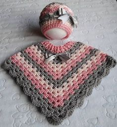 Stunning handmade baby poncho and hat. Made with coconut ice baby cakes yarn. Pink Peach and grey. Size Stunning handmade baby poncho and hat. Made with coconut ice baby cakes yarn. Pink Peach and grey. Crochet Pullover Pattern, Poncho Knitting Patterns, Crochet Poncho Patterns, Baby Knitting, Free Knitting, Baby Girl Crochet, Crochet Baby Clothes, Crochet For Kids, Hand Crochet