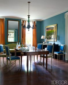 Julia Reed's New Orleans dining room by Thomas Jayne. Love the rich flame colored silk drapes against the jewel toned teal walls. Simple and striking. The Foo Dog Ate My Homework