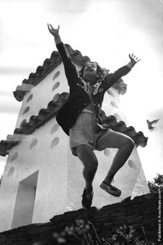 Salvador Dali cavorting on a rooftop at his home in Cadaques on the Spanish Costa Brava, 1955. (Photo by Charles Hewitt)