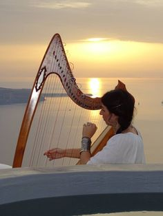 """""""Ode to the sun"""" songs & interview from Mrs. Eri Harperi. We were more than blessed to experience a magical journey through the tunes of the classical harp, during sunset! The performance and the interview took place at Sophia Luxury Suites."""