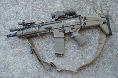 SCAR-L with sling, short barrel and covers over side rails. jdm