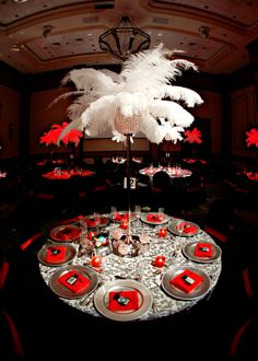 60th Birthday | Las Vegas | Casino Theme | Red | Black | White | Feathers | Grey Damask Linens | Silver Charger Plates #eventdecor #casino #centrepieces #tablescape #parasmehta