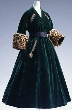 Coat Dress Autumn/Winter 1947 by Christian Dior, The Kyoto Costume Institute  Dark Green velvet; cuffs of leopard skin; gold thread, sequin and bead embroidery on bodice and pockets; black suede belt. ❤❦♪♫
