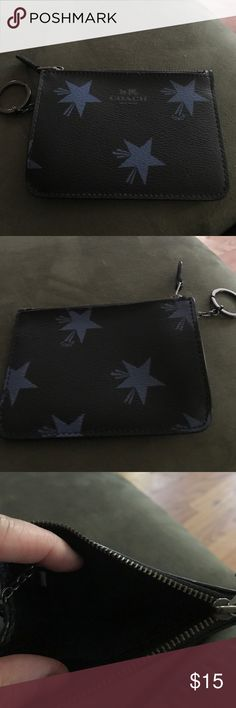 Black Coach small wristlet with key chain! Black Coach Wristlet with blue stars!! Really cute!! Excellent condition all over! Has a key chain too!! Coach Bags Clutches & Wristlets