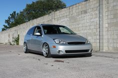 Low Silver Ford Focus mk1, big rims from USA