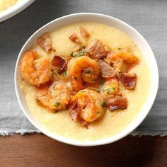 I was born and raised in the South. A few years ago I moved to Pennsylvania, where good Southern comfort food was hard to find. So I created these creamy, smoky Cajun shrimp and grits to remind me of home. —Kailey Thompson, Palm Bay, Florida Charleston Shrimp And Grits, Southern Shrimp And Grits, Shrimp And Cheesy Grits, Shrimp Grits, Cajun Dishes, Shrimp Dishes, Seafood Recipes, Appetizer Recipes, Cooking Recipes