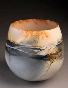 Not quite Raku but similar to me: Saggared fired vessel ~ By June Ridgway at Studiopottery.co.uk