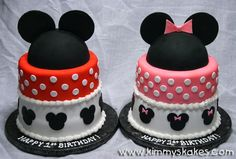 Mickey & Minnie - These were made for a set of twins, boy & girl. 9 & 8  rounds covered in fondant. The mickey & minnie hats were made out of gumpaste, molded over the Wilton sports ball pans. :-)