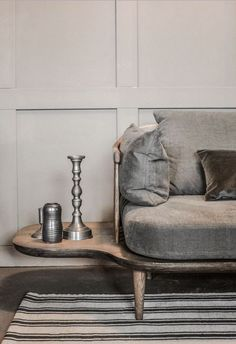 details, side end table, built on, linen, candlestick, texture, sophisticated, velvet, velour sofa, couch, wood, striped rug, subdued color palette, pillows, modern, silver, grey, slate, pigeon belly style, turned legs, wood floor, molding from: BenV