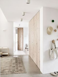 Wood closet doors and concrete flooring in neutral tone home