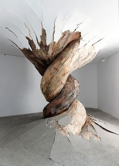 Brazilian artist Henrique Oliveira's incredible installations look like giant overgrown tumors or roots that are slowly taking over the spaces they inhabit breaking through doors, walls, floors, and ceilings. Created out of splintered and discarded plywood Oliveira's creations look like three dimensional wooden patchwork quilts that are taking over every nook and cranny they can, never stopping to ask for permission or directions.