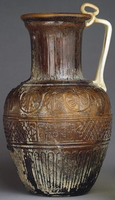 Mold-blown vessel signed by Ennion [Roman; Found on Cyprus] (17.194.226) | Heilbrunn Timeline of Art History | The Metropolitan Museum of Art