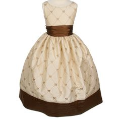 Gold Taffeta Crested Tea DressThis dress is beautiful gold and mocha taffeta. Bodice and skirt are fully lined with an additional layer of crinoline netting for added fullness. The bodice zips in the back with a fat over sized sash that ties over the zipper.