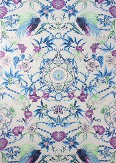 The Matthew Williamson Grey & Blue Menagerie Wallpaper. An ornate, fantastical patterned wallpaper featuring butterflies, exotic birds and mischievous monkeys. This print was originally hand-painted in our London studio for the Mother Amazon print, as seen on dresses, skirts and shirts for Spring 2016. Persian blue and violet are richly colourful against the grey base of the wallpaper.