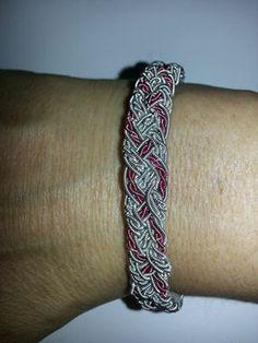Armband flätat med tenntråd och rosa koppartråd
