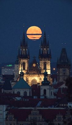 Full Hunter's Moon over Tyn Church in Prague, Czech Republic