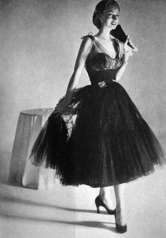 Model wears an evening gown for Vogue US, 1951.