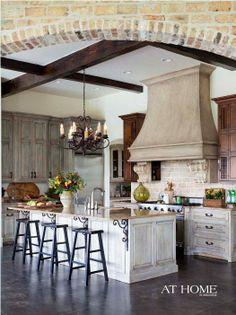 cabinets,  wood  beams  and  brick