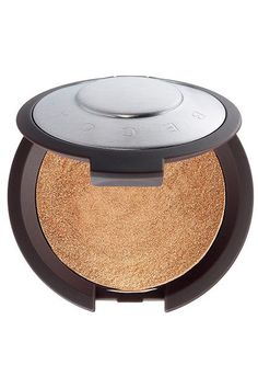 For those of you looking for cheekbones that send messages to space, this golden highlighter will be right up your alley. Becca Shimmering Skin Perfector Pressed in Topaz, $38, available at Sephora. #refinery29 http://www.refinery29.com/highlighters-makeup-for-dark-skin#slide-1