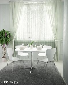 Minimalist and elegant dining room design with white color.