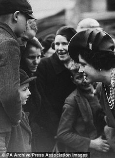 Queen Elizabeth (later the Queen Mother) 1941 - visiting East Enders in London after a Nazi bombing raid.  This woman donned a hat, gloves and sensible shoes and met the war head on, square in the face.  She and King George VI kept up moral among the people in the face of devastating destruction and death that most of us can't imagine.  Adolph Hitler called her the most dangerous woman in Europe.