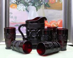 Avon Cape Cod Collection. Ruby Color Glass Short Footed Pitcher and Six Tumblers. Collectible Avon Ruby Glass.