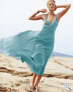 Cotton-Gauze Long Dress  Breezy crinkled cotton gauze and swingy styling are supported by twisted knit straps. The racerback V-neck style is lined with tissue-weight jersey and flares to a dramatic ankle-length hem