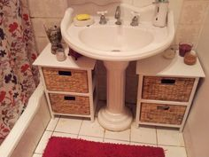 Bathroom storage - use small storage cabinets keep supplies neat under a pedestal sink.