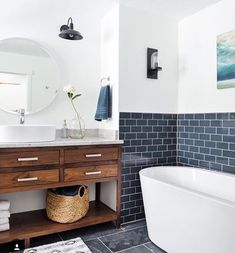 I really like the dark wood vanity and the navy subway tile.