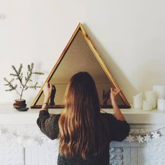Reclaimed Wood Triangle Mirror with bronze tinted glass. This statement piece is handmade from wood salvaged from old Chicago buildings. The bronze glass gives it a slightly vintage feel.