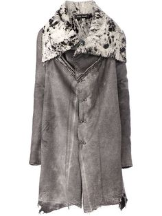 Tsolo Munkh handcrafted rough finish shearling coat from L'Eclaireur, Paris, France.